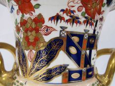 A German Imari style footed vase with bird decoration (hairlined), 26.