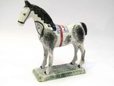 A circa 1790 Staffordshire standing horse on square base with sponged decoration,
