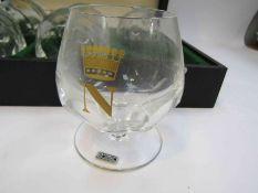 A cased set of six Schonwalder Napoleon brandy glasses with gilt crown decoration