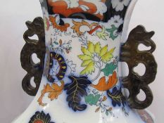A pair of late 19th/early 20th Century Chinese style vases,