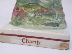 Two 18th Century Staffordshire figures including Charity, slight areas of damage,