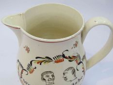 """An 18th Century creamware jug """"We 3 logerheads be 1783"""", hairline to spout,"""