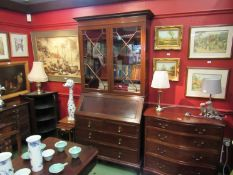 An astragal glazed mahogany cabinet on bureau base, two short over two long drawers.