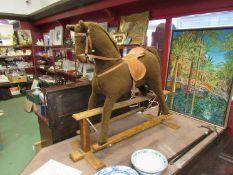 A Mamas & Papas soft bodied rocking horse,