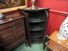 """A George III oak bow front two door wall hanging corner cupboard with """"H"""" hinges,"""