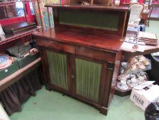 A Circa 1800 mahogany chiffonier the three quarter pierced brass gallery and raised shelf on reeded
