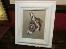 RYAN: Oil on board depicting a donkey, in white painted frame,