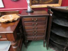 An Edwardian six drawer music cabinet,