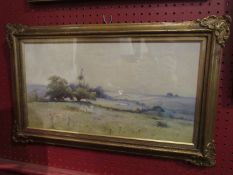 A watercolour depicting rural landscape, sheep grazing, gilt framed and glazed,