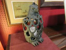 A metal candle holder as a bird