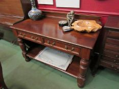 A mahogany two drawer side table with gallery back and undertier,