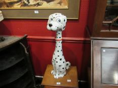 """An Italian Pottery figure of a Dalmation wearing a red bow collar. Painted """"Italy"""" to base."""