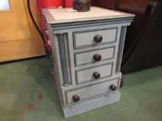 A painted four drawer bed side chest,