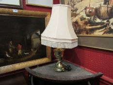 A brass table lamp with shade,