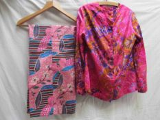 An Elida, London pure silk blouse and trouser suit, electric pink and purple floral pattern,