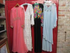 Four 1960's/70's full length evening dresses, salmon pink with gold lace trim, cream lace,