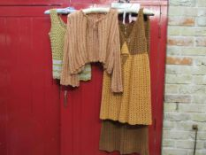 A 1960's crochet two piece suit in yellow and brown and two chrochet tops in tones of gold (4)