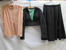 Two items of 1970's clothing including a Louis Feraud black and grey two piece suit with emerald