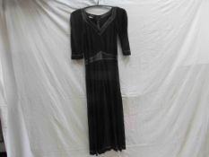 A Jean Muir iconic 1970's black rayon jersey full length dress with chocolate brown leather V neck