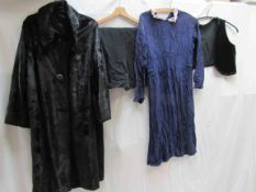 Four items of early 20th Century clothing, a black moleskin coat,
