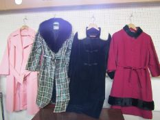 Four late 1960's early 70's coats, one with a matching dress, black velvet with pale mink collar,