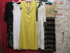 Five 1960's full length evening dresses, black crepe chiffon with gold flowers,