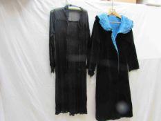 An early 20th Century black velvet eveing coat with blue velvet lining,
