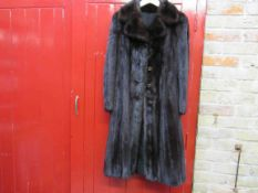 A 1950's/60's dark brown mink fur coat with stylised buttons