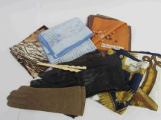 A quantity of fine leather gloves and silk scarves and a glove stretcher