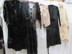Three early 20th Century ladies black dresses, various styles,