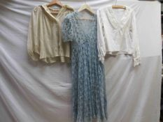 Two early 20th Century cotton blouses and a light blue garment of segmented flowers