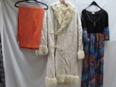 An Iconic 1970's cream shaggy sheepskin coat with frogging fastening,