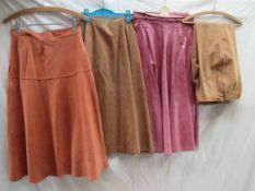 """Two 1970's suede skirts in coral and camel, a Modele edition """"Maggy Rouff Paris"""" label,"""