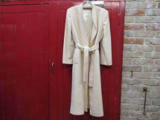 A 1970's Anglo fabrics label Merino Extrature wool edge to edge coat,