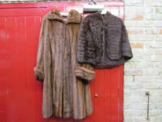 A Brahms of Norwich vintage 1950's mink fur coat with wide turn back cuff and a brown squirrel fur