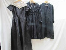 A 1940's black fine grosgrain full length evening dress with a cream lace collar, a black day dress,