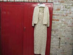 A 60's/70's Harrods cream irredescent and gold sequin halter neck full length evening dress and