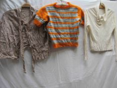 Three items of 1930's clothing, knitted orange jumper, short sleeve with bands of blue and cream,