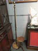 A turned oak standard lamp and a tripod occasional table of small proportions (2)