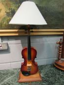 A violin form lamp with shade,