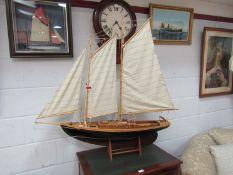 A wooden model schooner, approx.
