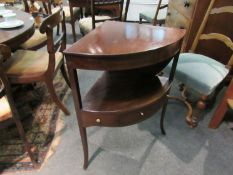 A mahogany three drawer corner washstand with hinged top,
