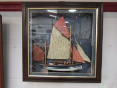 A framed diorama of a ship