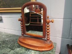 A Victorian mahogany dressing table mirror with bobbin turned supports,