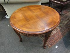 A French style parquetry circular top occasional table on carved cabriole legs,