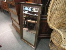 A bevel edged framed wall mirror,