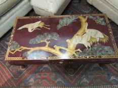 An Oriental lacquered rectangular top occasional table on cabriole legs,