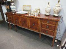 A modern burr wood sideboard, three cupboard doors flanked by six drawers, leg a/f, 214cm long,