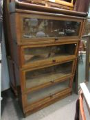 An oak Globe-Wernicke & Co of London four tier stacking bookcase with glazed doors,
