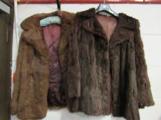 Two period chocolate brown fur jackets